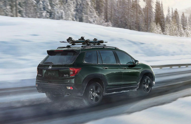 2020 Honda Passport driving on a snow covered road