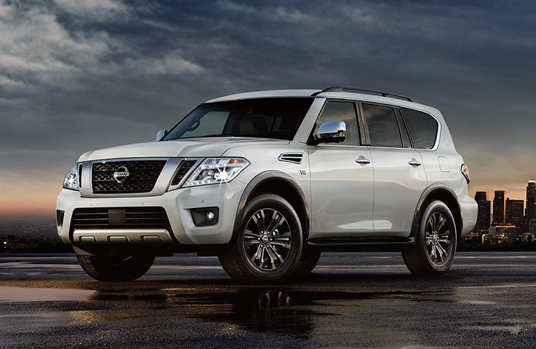 2018 nissan armada in silver parked in front of sunset