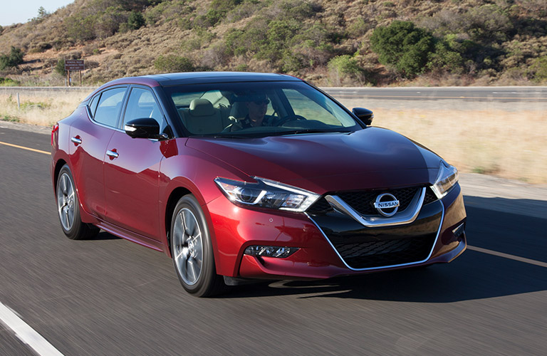 2018 nissan maxima red driving on highway