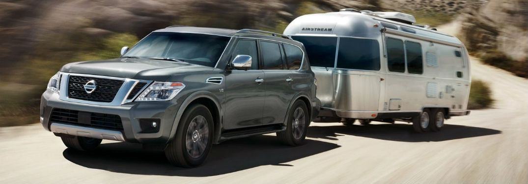 2018 nissan armada towing a chrome airstream trailer in the desert