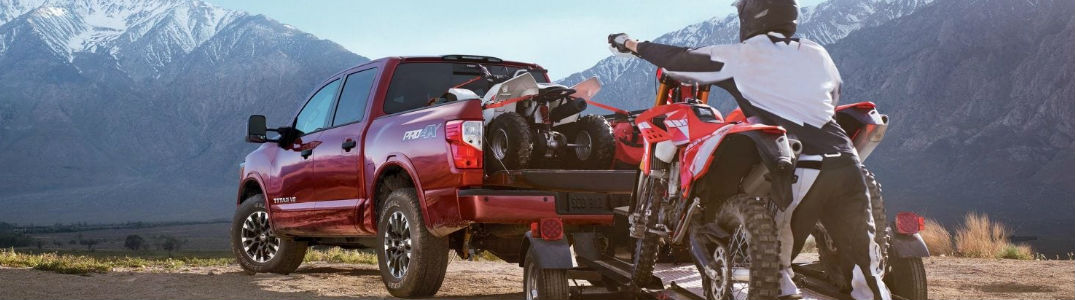 2019 Nissan Titan with a dirt bike in the cargo bed