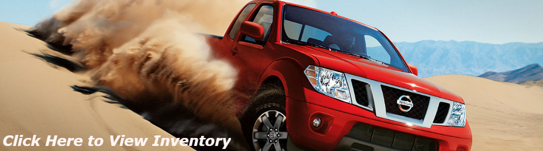 Nissan Frontier driving on sand