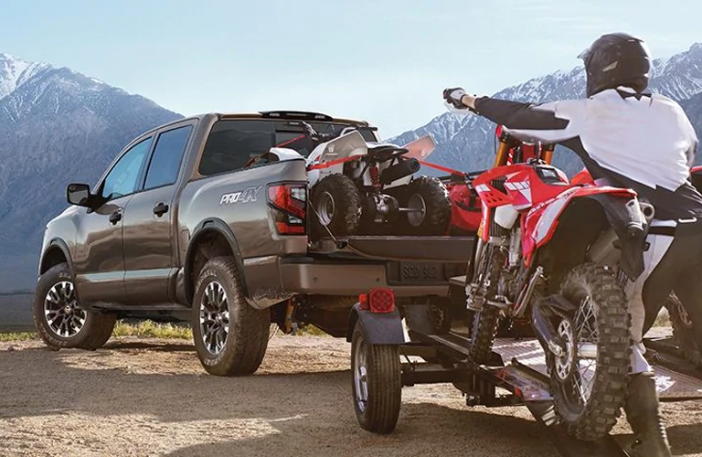 2020 Nissan TITAN with a dirt bike in the bed