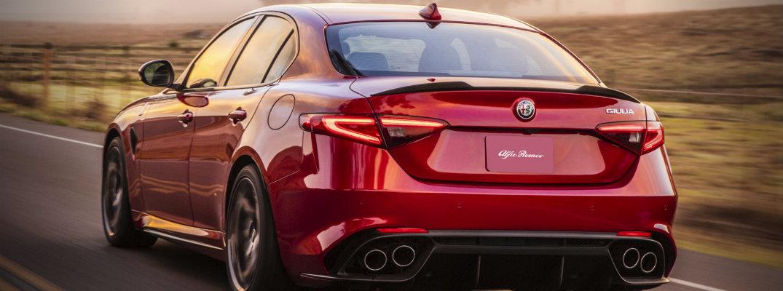 Rear shot of 2018 Alfa Romeo Giulia Quadrifoglio driving down country road