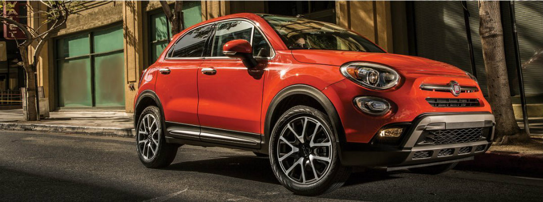 Profile shot of red 2018 Fiat 500X parked on city street