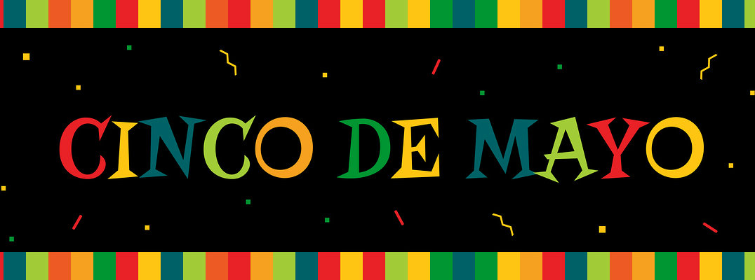 """Banner in traditional Mexican colors with """"Cinco De Mayo"""" written in center"""