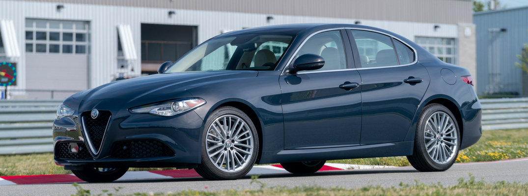 Blue 2019 Alfa Romeo Giulia driving on track