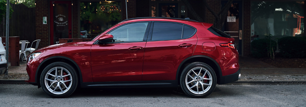 side view of red 2019 alfa romeo stelvio