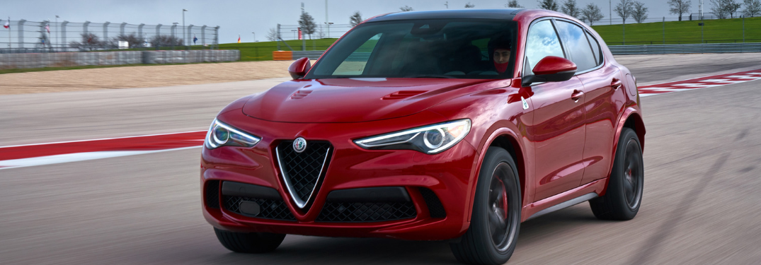 front and side view of red 2019 alfa romeo stelvio quadrifoglio