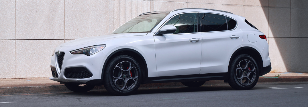 front and side view of white 2019 alfa romeo stelvio