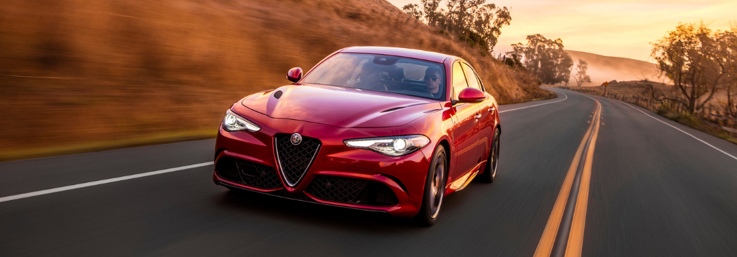 front and side view of red 2019 alfa romeo giulia quadrifoglio