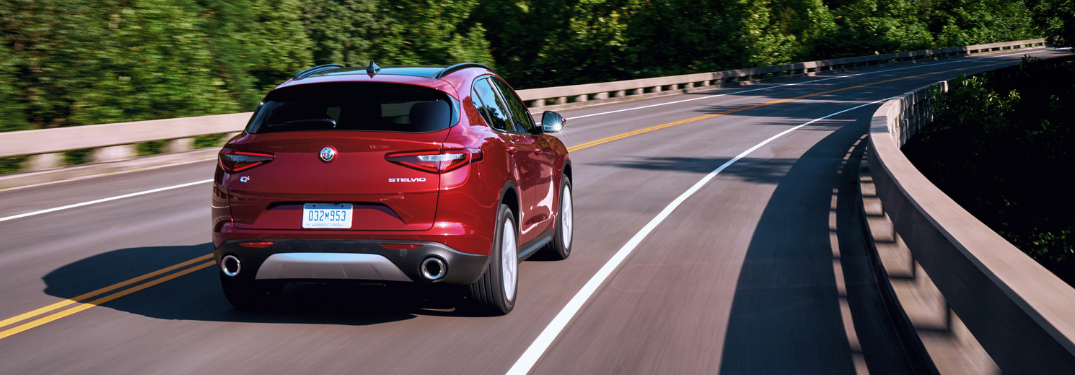 rear and side view of red 2019 alfa romeo stelvio