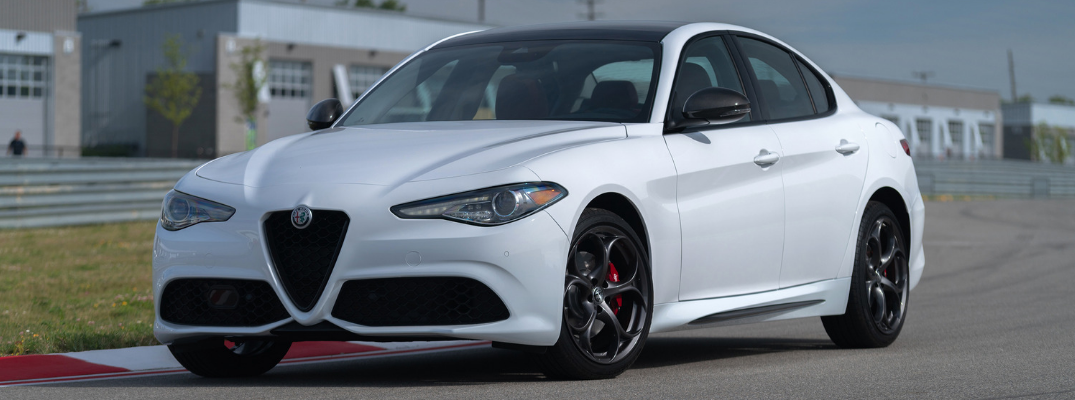 front and side view of white 2019 alfa romeo giulia with ti sport carbon fiber package