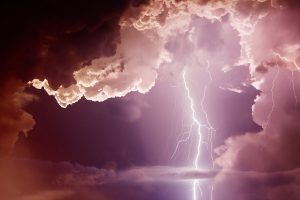 pink sky with lightning and clouds