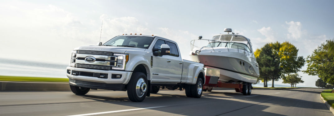 2018 f-series super duty in white towing a boat