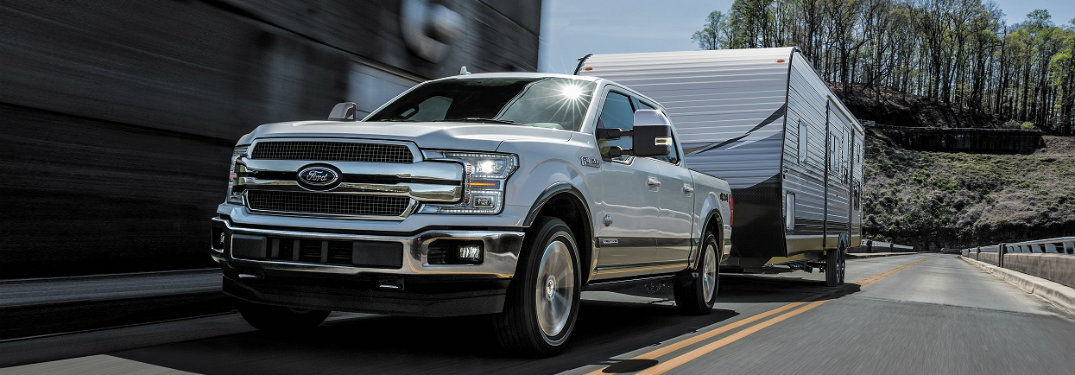 white ford f-150 pulling a trailer