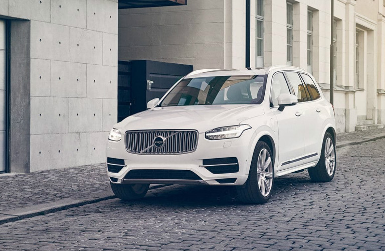 2018 Volvo XC90 in white parked on a cobblestone street