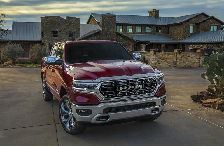 2019 RAM 1500 in red parked in front of a cabin