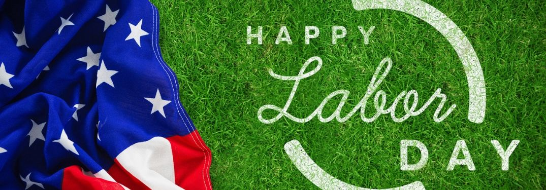 "American flag over grass with ""Happy Labor Day"" text"