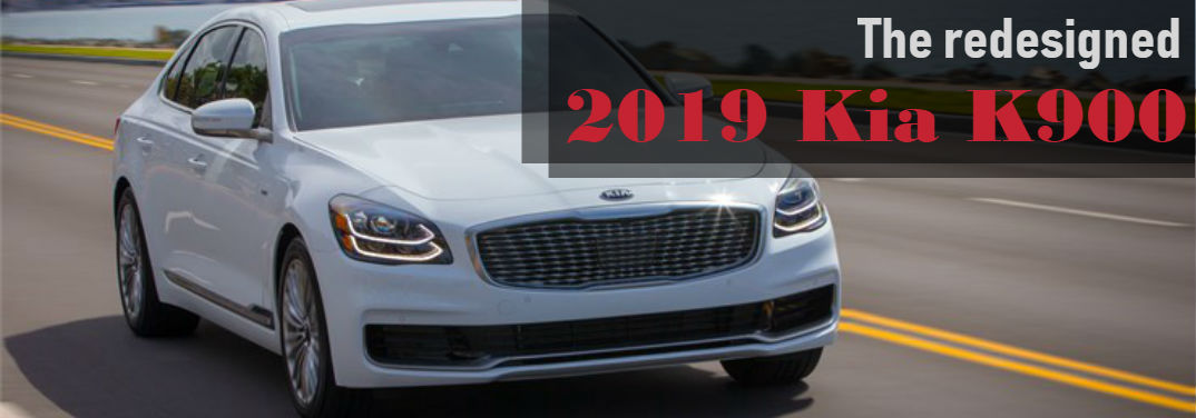 The Redesigned 2019 Kia K900 with image of a 2019 K900 driving down a highway with water and a city in the background