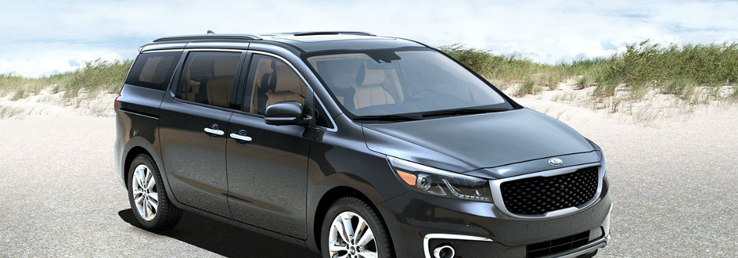 2018 Kia Sedona Family-Friendly Features with image of the Sedona parked at a beach