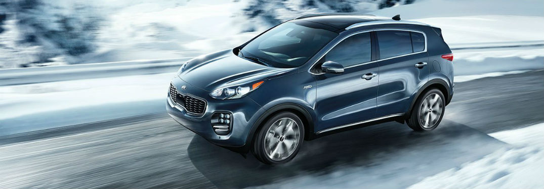 2019 Kia Sportage Performance and Specs with image of 2019 Sportage with AWD driving on a snowy road