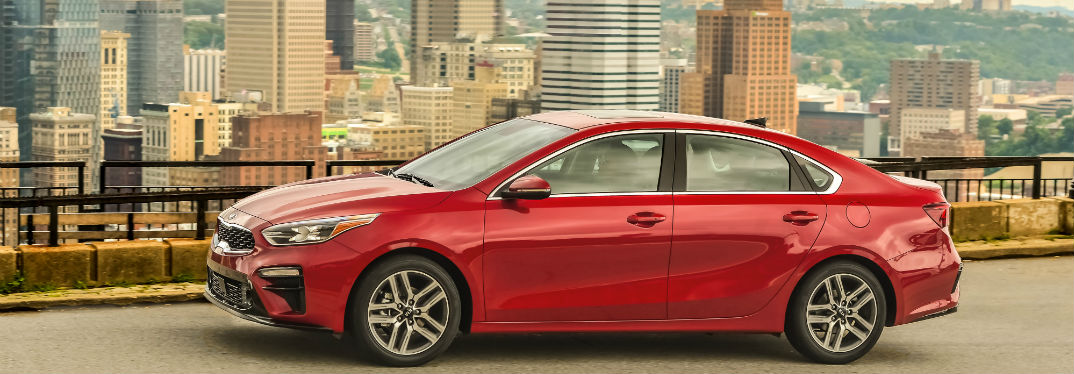 2019 Kia Forte Design and Performance Overview with image of 2019 Kia Forte parked with a skyscape