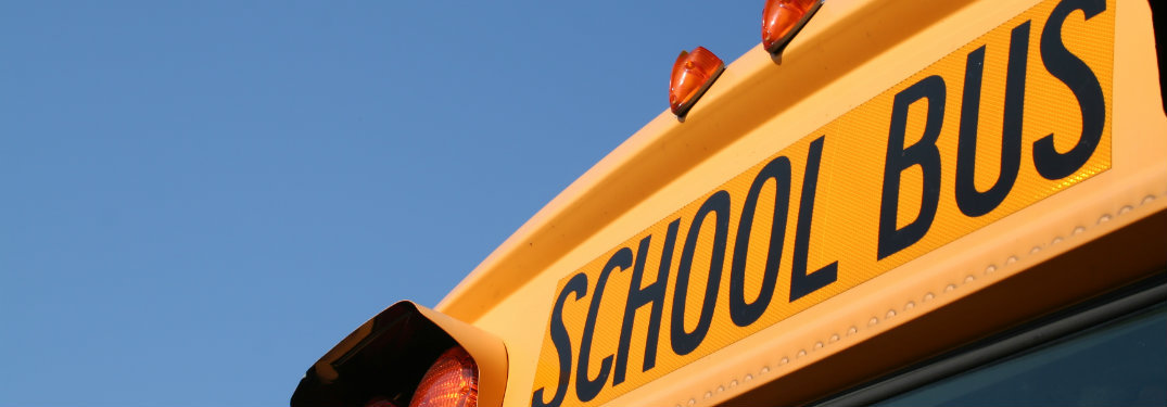 When should I stop for a school bus?