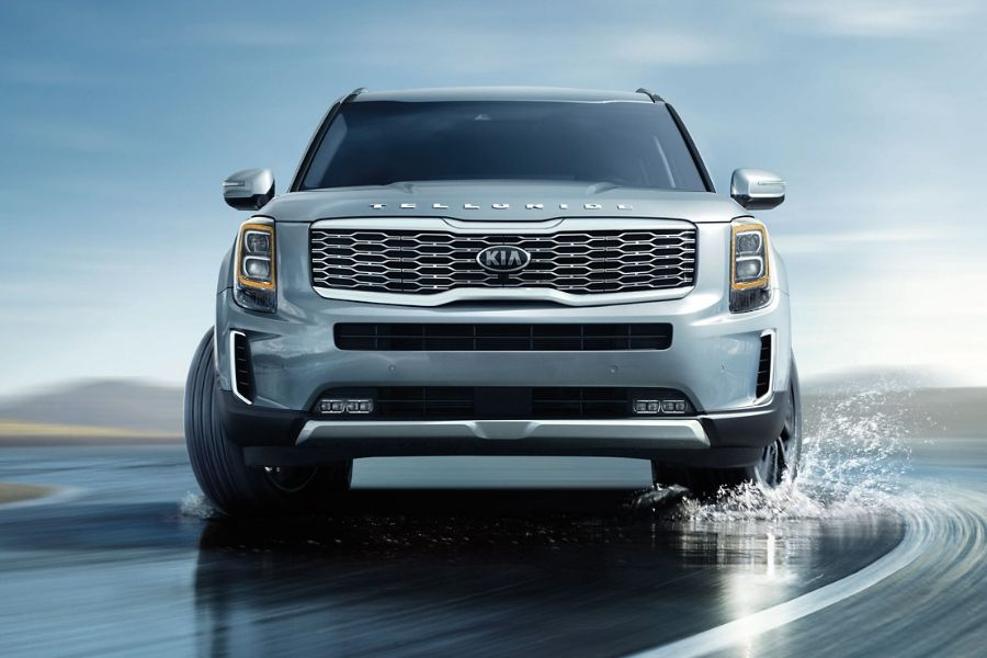 2020 Kia Telluride from front driving down wet road
