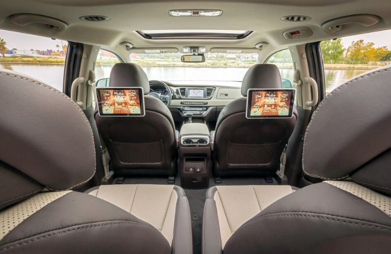 Interior view of 2020 Kia Sedona from third row seats showing screens