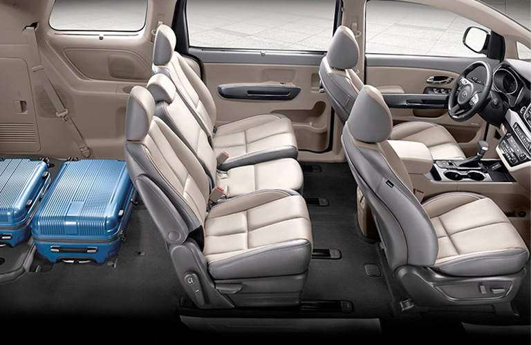 Side view of 2020 Kia Sedona interior with coolers in trunk