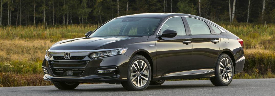 side view of 2018 Honda Accord Hybrid parked near a forest