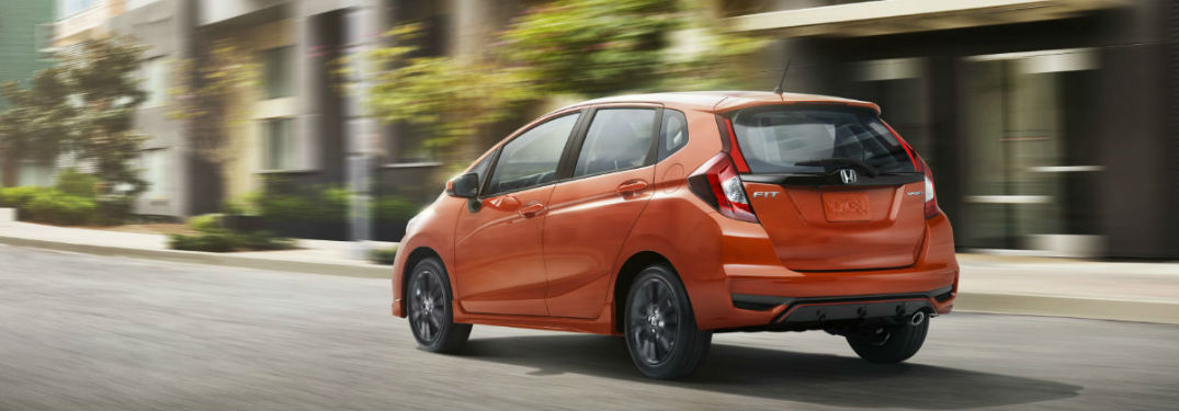 orange 2018 Honda Fit driving