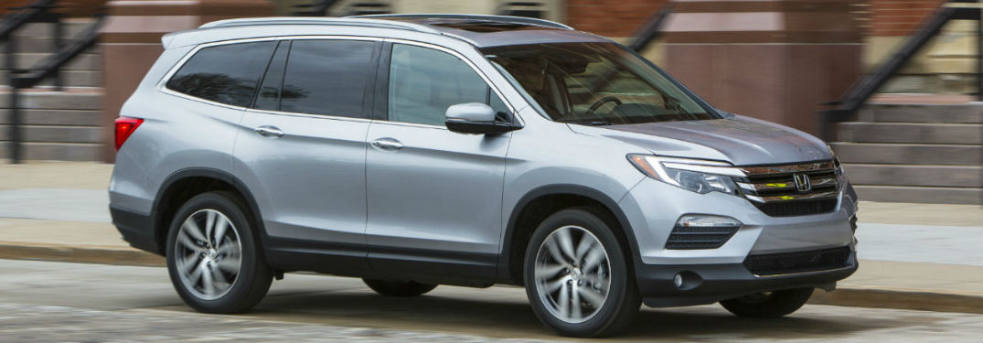 silver 2018 Honda Pilot parked on the street