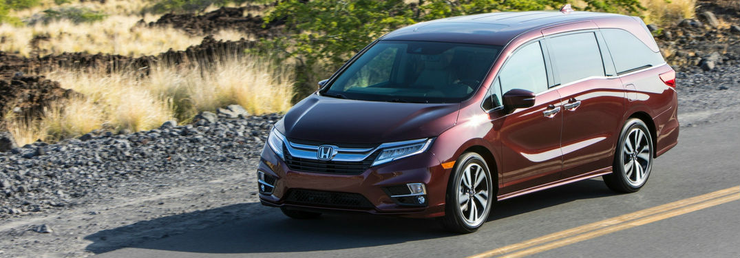 2019 Honda Odyssey driving down a road