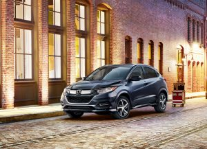 2019 Honda HR-V Touring parked by a building with its lights on