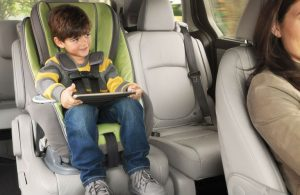 2018 Honda Odyssey with Magic Slide 2nd-Row Seats with toddle in a car seat moved to the middle