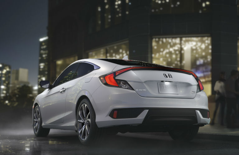 2019 Honda Civic Coupe driving around a city at night