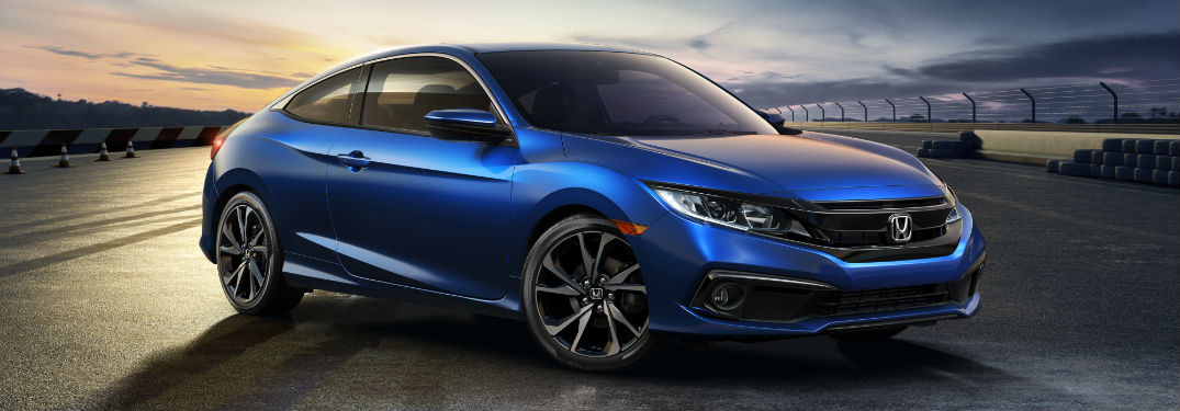 2019 Honda Civic Coupe Pricing and Specifications with an image of a 2019 Honda Civic Coupe parked at a race track at twilight