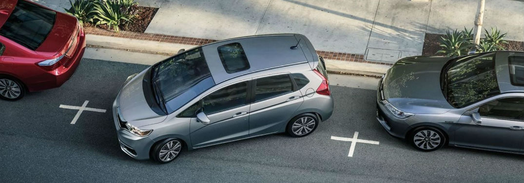2019 Honda Fit Benefits for Teen Drivers with image of a 2019 Honda Fit EX-L parallel parking in a city