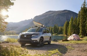 2019 Honda Passport parked at a camping site by a lake