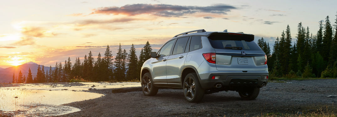 Honda Debuts the 2019 Honda Passport with an image of a 2019 Honda Passport overlooking a sunset by a lake and mountains