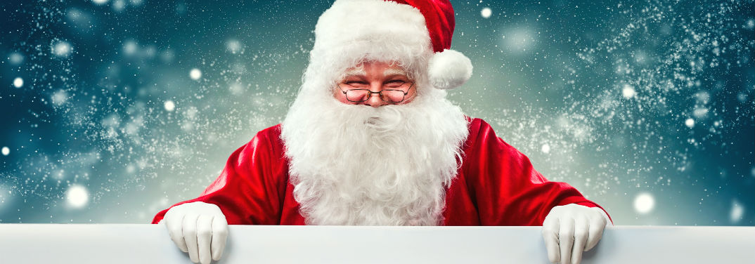Take Pictures with Santa near Bay Shore, NY with an image of Santa Claus holding a white border