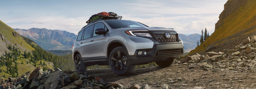 2019-Honda-Passport-with-car-top-carrier-driving-on-rocky-terrain