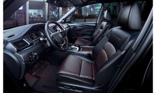 2020 Honda Pilot interior side shot of front seating and interior black leather upholstery and accent stitching