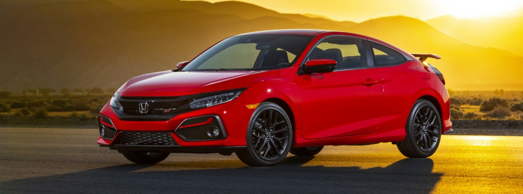 2020 Honda Civic Si Coupe exterior shot with rallye red paint color parked outside in a desert as the sun sets