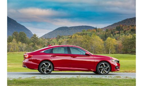 2020 Honda Accord Sport with San Marino Red paint color exterior side shot parked near a grass field