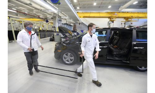 service technicians equipping and modifying Honda Odyssey minivan models for COVID-19 testing in Detroit