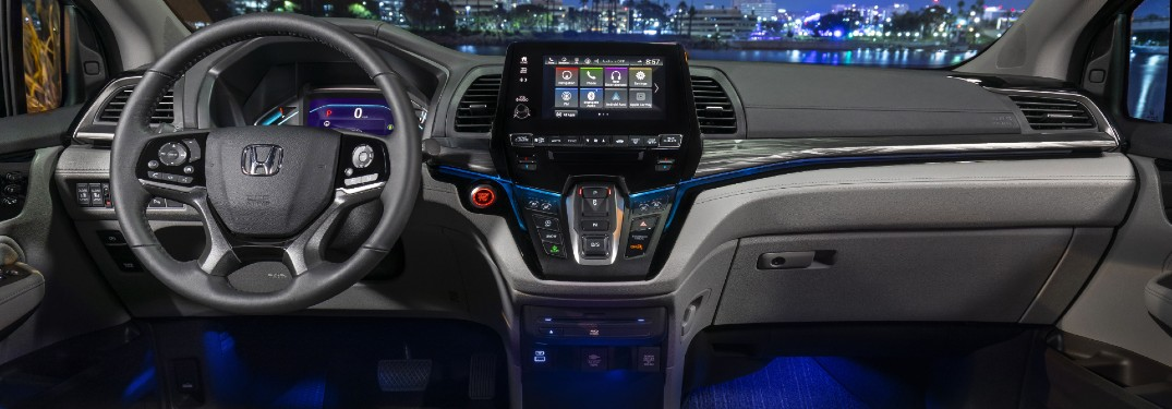 2021 Honda Odyssey interior shot of steering wheel, transmission, infotainment screen, and dashboard layout