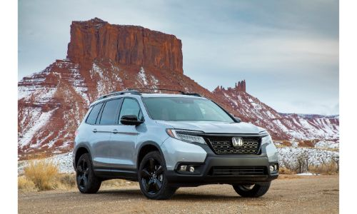 2020 Honda Passport exterior shot parked in a desert mountain setting with Lunar Silver Metallic paint color